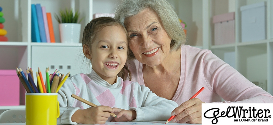 senior coloring with her granddaughter