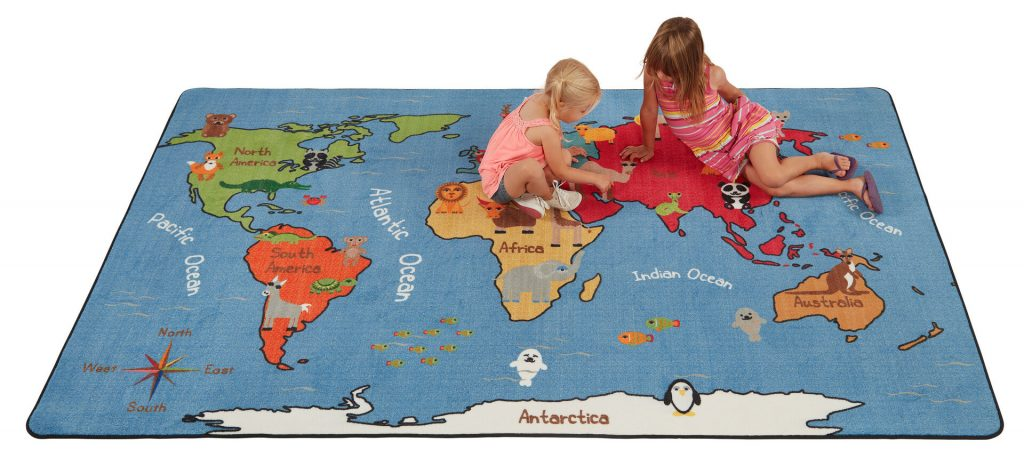 children playing on rug with world map