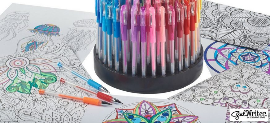 gel pens in stand on coloring book pages